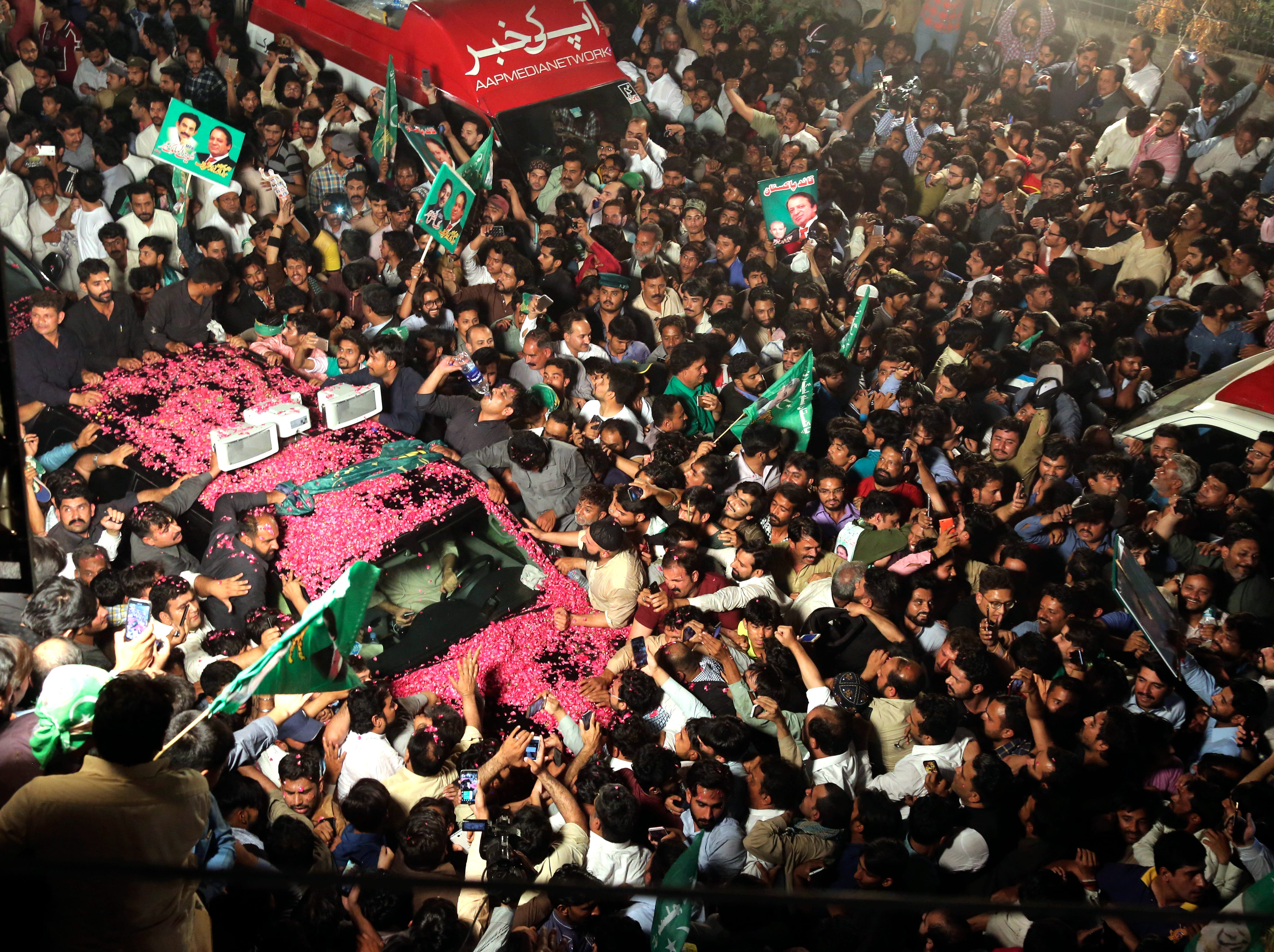 Supporters of Pakistan's former Prime Minister Nawaz Sharif surround his vehicle, on his way to the Kot Lakpat jail in Lahore, Pakistan, Tuesday, May 7, 2019. Sharif returns back to prison after six weeks out on bail to receive medical treatment ended. Sharif was ousted from office by the Supreme Court in 2017 because of the corruption charges against him.