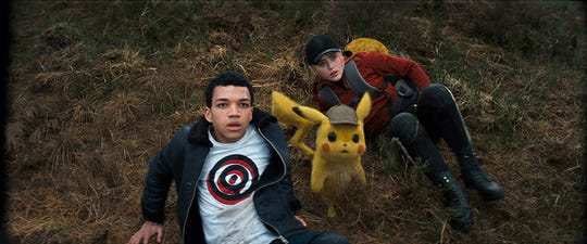 "Justice Smith and Kathryn Newton in ""Detective Pikachu."""