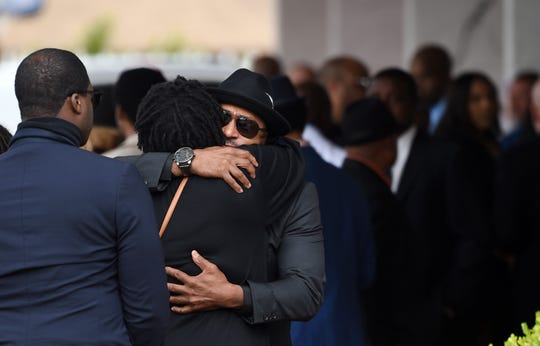 Guests at a memorial service for the late film director John Singleton embrace at Angelus Funeral Home, Monday, May 6, 2019, in Los Angeles.