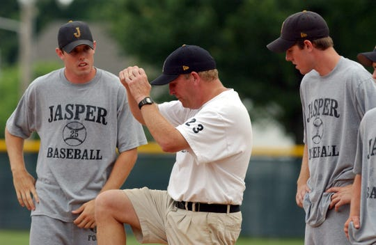 Jasper coach Terry Gobert works with Ben Schmidt (left) and his brother, Chris, on their baserunning techniques during a practice in 2003.