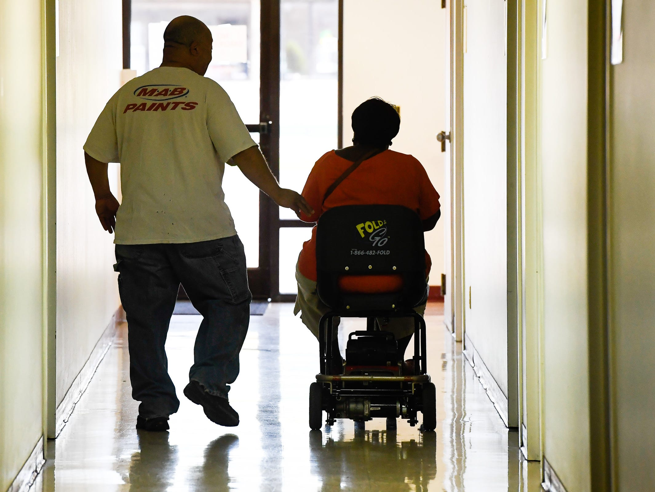After voting, Phillip and Brenda Taylor make their way out of the Memorial Baptist Church voter center Tuesday, May 7, 2019.