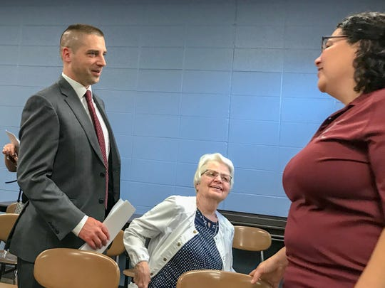 Matt Thompson, left, talks with Metropolitan School District of Mount Vernon board meeting attendees after being appointed superintendent.