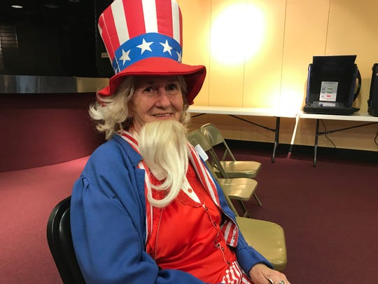 Jan Rhodes dressed as Uncle Sam as she worked as lead judge at Washington Square during Primary Elections 2019.