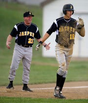 Jasper coach Terry Gobert, arguing an umpire's call in the background, joined the prestigious 800-victory club. He is one of five coaches in state history to achieve that mark.