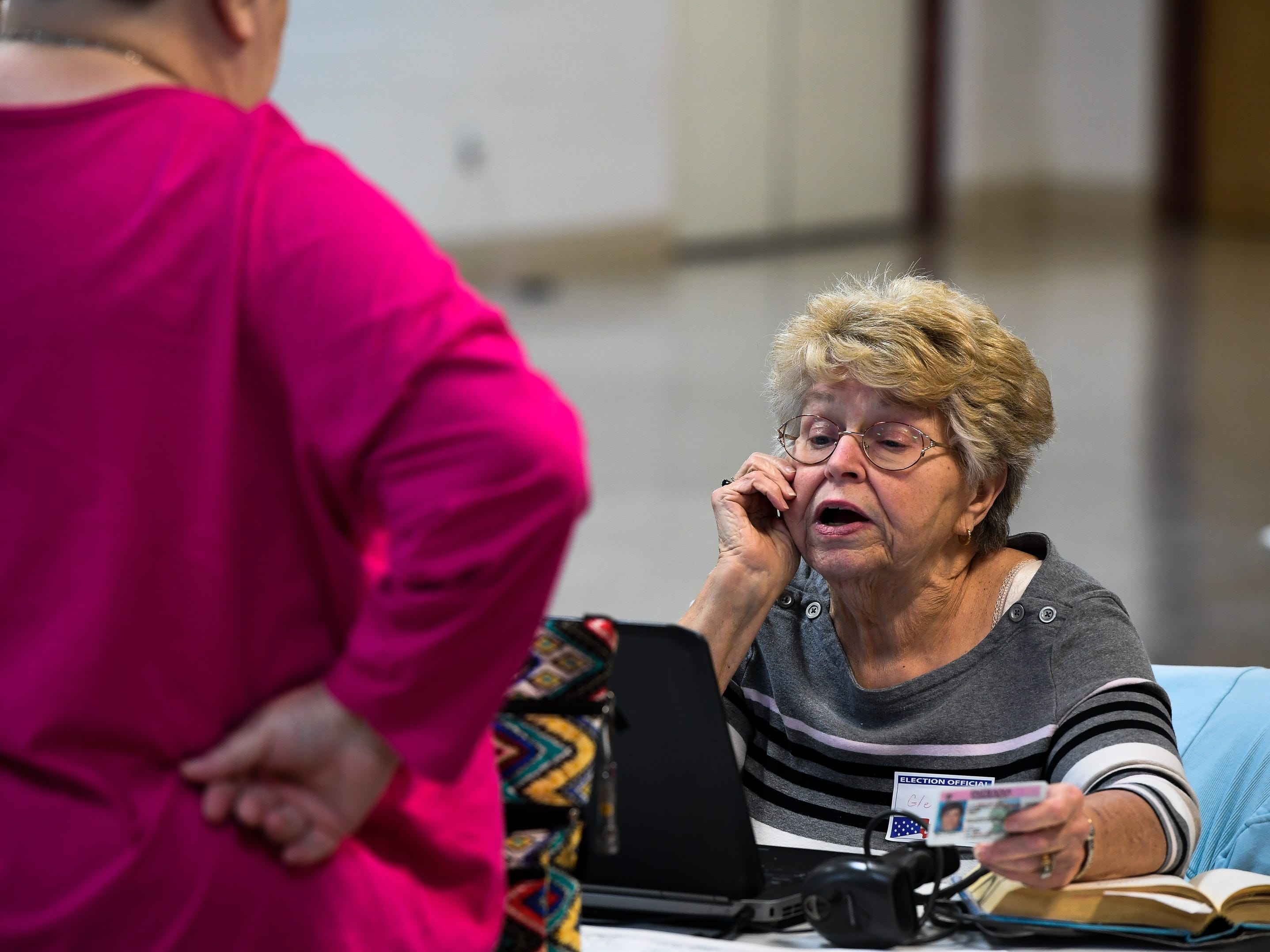 Election clerk, Glenda Gilham checks in a voter at the Methodist Temple on Lincoln Avenue in Evansville Tuesday, May 7, 2019.