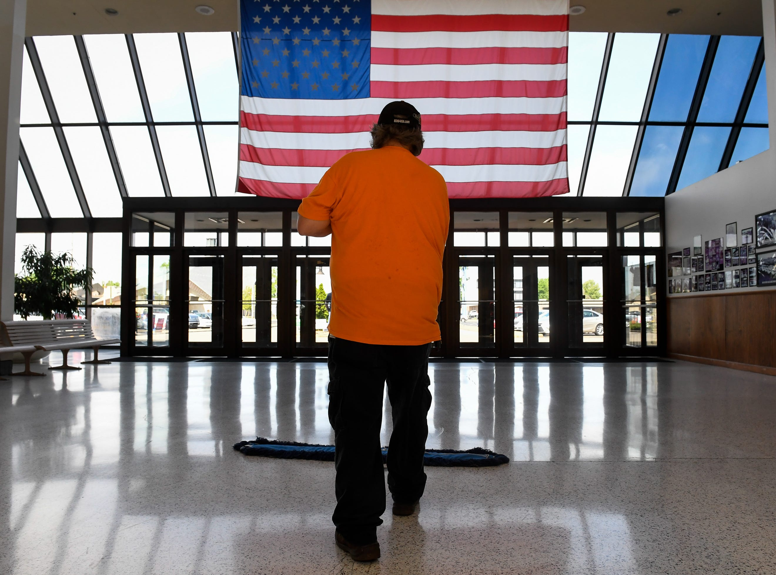 David Kendall keeps the entrance clean at the Washington Square voting center Tuesday, May 7, 2019.