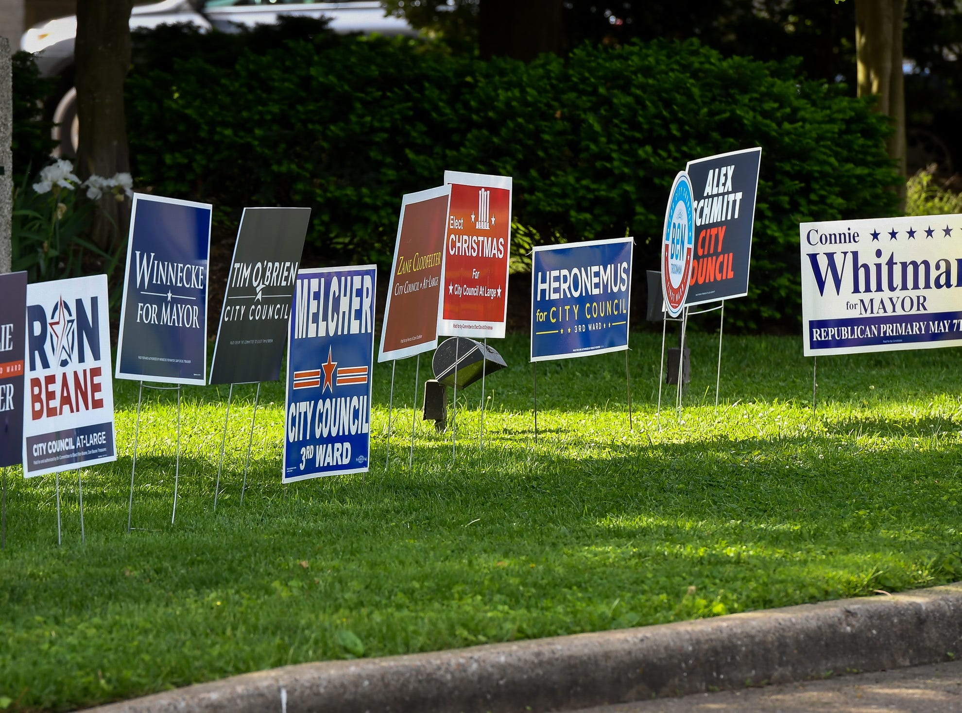 Campaign signs line the entrance to the voting center at the Methodist Temple on Lincoln Avenue in Evansville Tuesday, May 7, 2019.