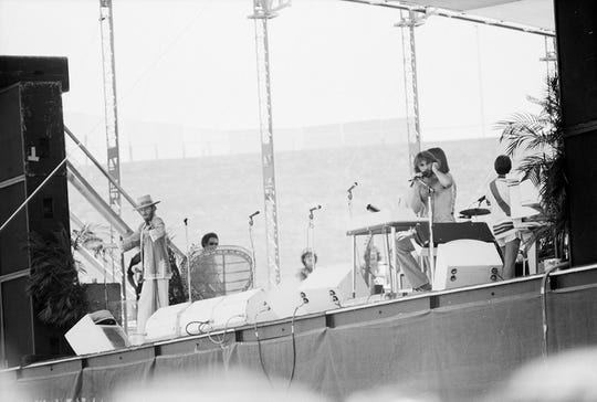 Chicago performing on stage at Hughes Stadium in July 1975.
