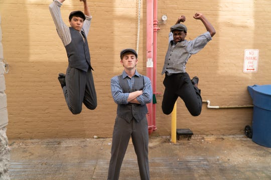 "Christian Dinsmore, Sawyer True and Keehnon Jackson in  a publicity photo for Florida Rep's ""Newsies."""