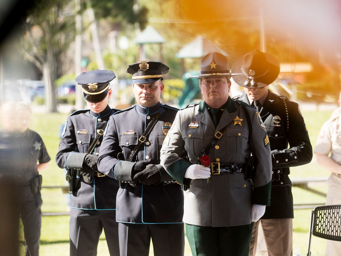 Officers from several Lee County angencies honor Sanibel Police Officer, Anthony Neri at the Lee County Fallen Officer Memorial Ceremony at Centennial Park on Tuesday May, 7, 2019. He died on Monday during a training excersize of natural causes.