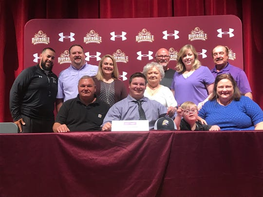 Riverdale senior TJ Barfield signed to play football at Sewanee in  Tennessee surrounded by his family on Tuesday.