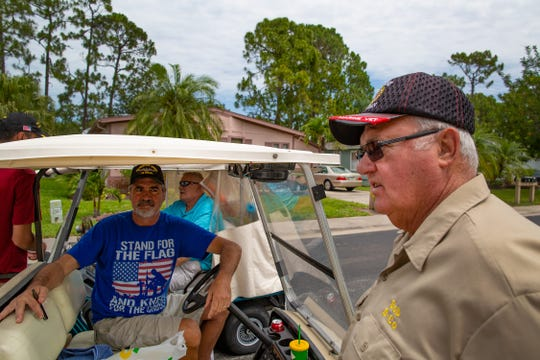 Bob Masson, 71 a Marine Vietnam War vet talks to his neighbors who came out to support him include Richard Dzedzej, left, at the Del Tura Golf & Country Club in North Fort Myers Tuesday, May 7, 2019. Community officialsÊsent Bob Masson, the mural's owner, a letter asking him to remove the depiction. Apparently there also had been a complaint.
