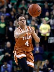 Texas guard Destiny Littleton (4) makes a pass during an NCAA college basketball game against Baylor in Waco, Texas, Monday, Feb. 25, 2019. (AP Photo/Tony Gutierrez)