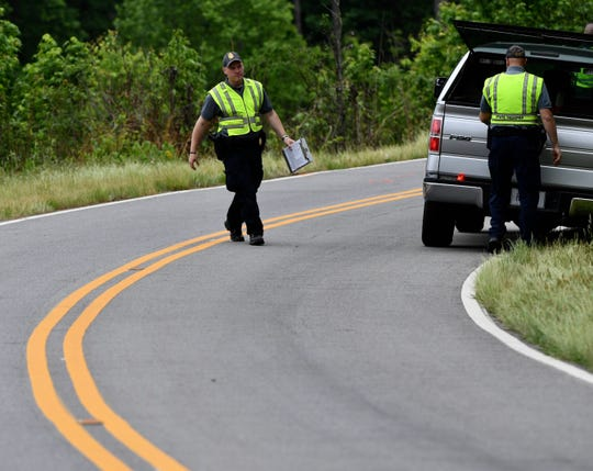 South Carolina Highway Patrol officers investigate on Latimer Mill Road, the scene of a deadly early morning DUI crash outside Honea Path in Greenville County, on Tuesday, May 7, 2019.