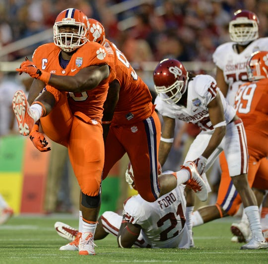 Clemson defensive tackle Grady Jarrett (50) celebrates after bringing down Oklahoma running back Keith Ford (21) during the 1st quarter of the Russell Athletic Bowl Monday, December 29, 2014 in Orlando, Fl.