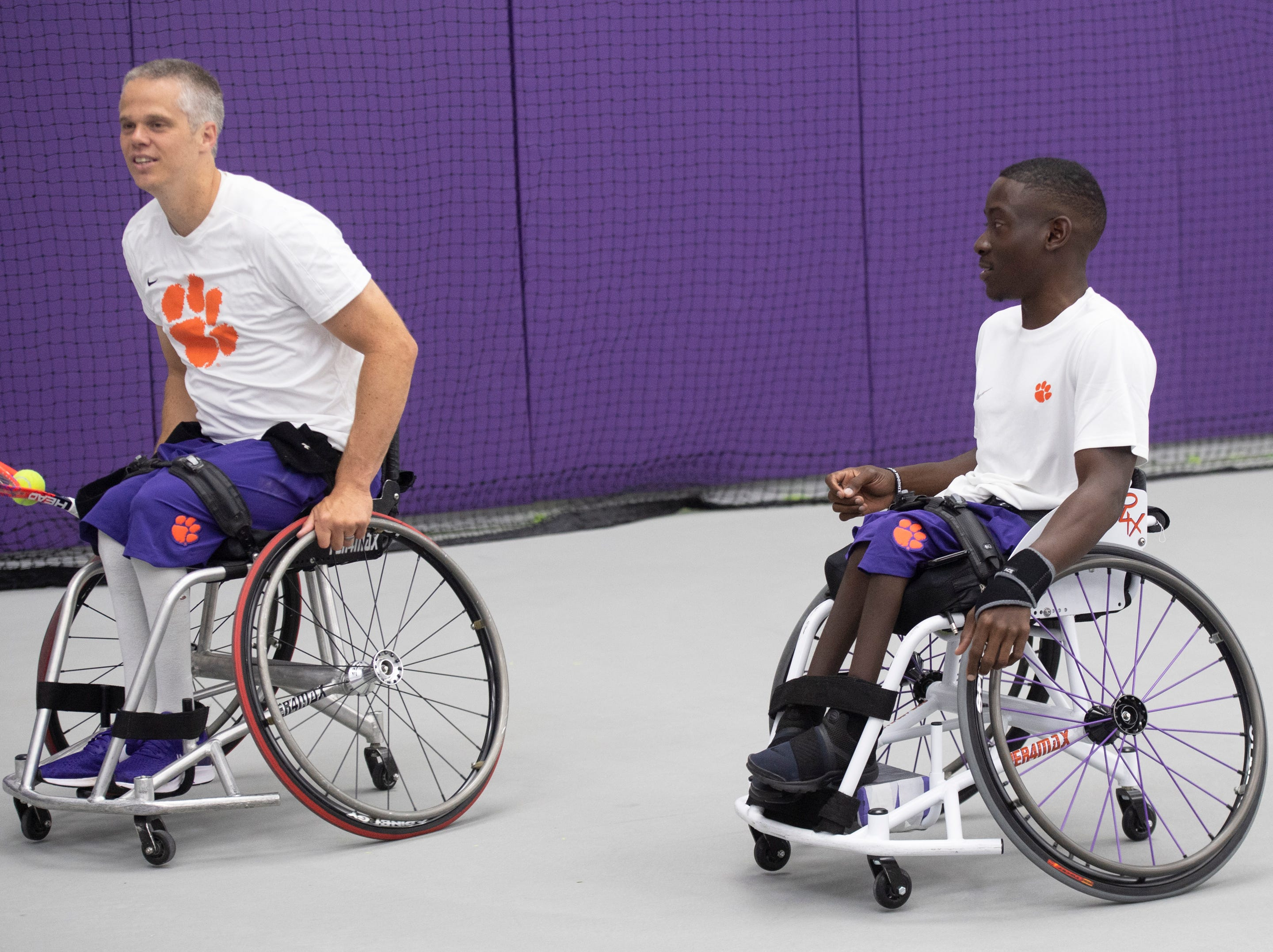 Jeff Townsend (left) and Marsden Miller warm up before tennis practice at Clemson University Friday, May 3, 2019.