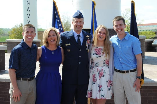 Brig. Gen. Ty Neuman (center), director of the Commander's Action Group for U.S. Strategic Command, is pictured with his family (from right to left), his son Trevor, his wife Shellie, his daughter Abbie and his son Jacob during his promotion ceremony to the rank of brigadier general at Offutt Air Force Base, May 3, 2019. As a child in Montana, Neuman was introduced to the Air Force by his father, who served in the Montana Air National Guard. This introduction provided him the opportunity to see what the Air Force was about and further fueled his interest in aviation.