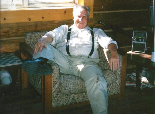Charles Jacobson relaxes at one of his favorite places, his cabin near Monarch.