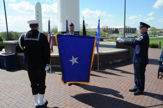 The Brigadier General flag is unfurled for Brig. Gen. Ty Neuman (center), director of the Commander's Action Group for U.S. Strategic Command, during his promotion ceremony at Offutt Air Force Base, May 3, 2019. Since June 2018, Neuman has led an eight-member team dedicated to supporting the commander and staff in development and implementation of the commander's strategic engagement, strategy, vision and intent.