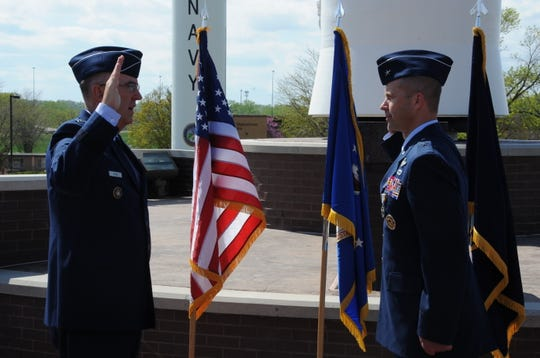 Gen. John Hyten, left, commander of U.S. Strategic Command (USSTRATCOM), delivers the reaffirmation of the oath of enlistment to Brig. Gen. Ty Neuman, director of the Commander's Action Group for USSTRATCOM, during Neuman's promotion ceremony to the rank of brigadier general at Offutt Air Force Base, May 3, 2019. Neuman will become the principal assistant deputy administrator for military application in Washington D.C. He will serve as a liaison between the Department of Defense (DoD) and the Department of Energy's National Nuclear Security Administration to ensure the DoD's best interests are properly conveyed when working acquisitions for various components within the military.