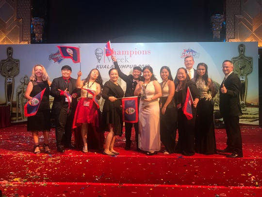 Floord manager Keaolani Sewell, center, displays the trophy won by KFC Guam at the annual KFC Asia Pacific competition held in Kuala Lumpur Malaysia April 23-24. The award was presented by KFC Asia General Manager Valerie Kubizniak, far left.