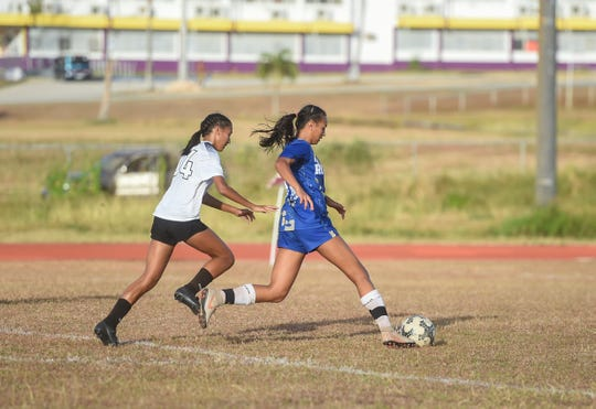 Notre Dame's Brianne Leon Guerrero dribbles the ball downfield against the Academy Cougars during an IIAAG Girls Soccer match at George Washington High in this May 6 file photo. Leon Guerrero was named the league MVP.