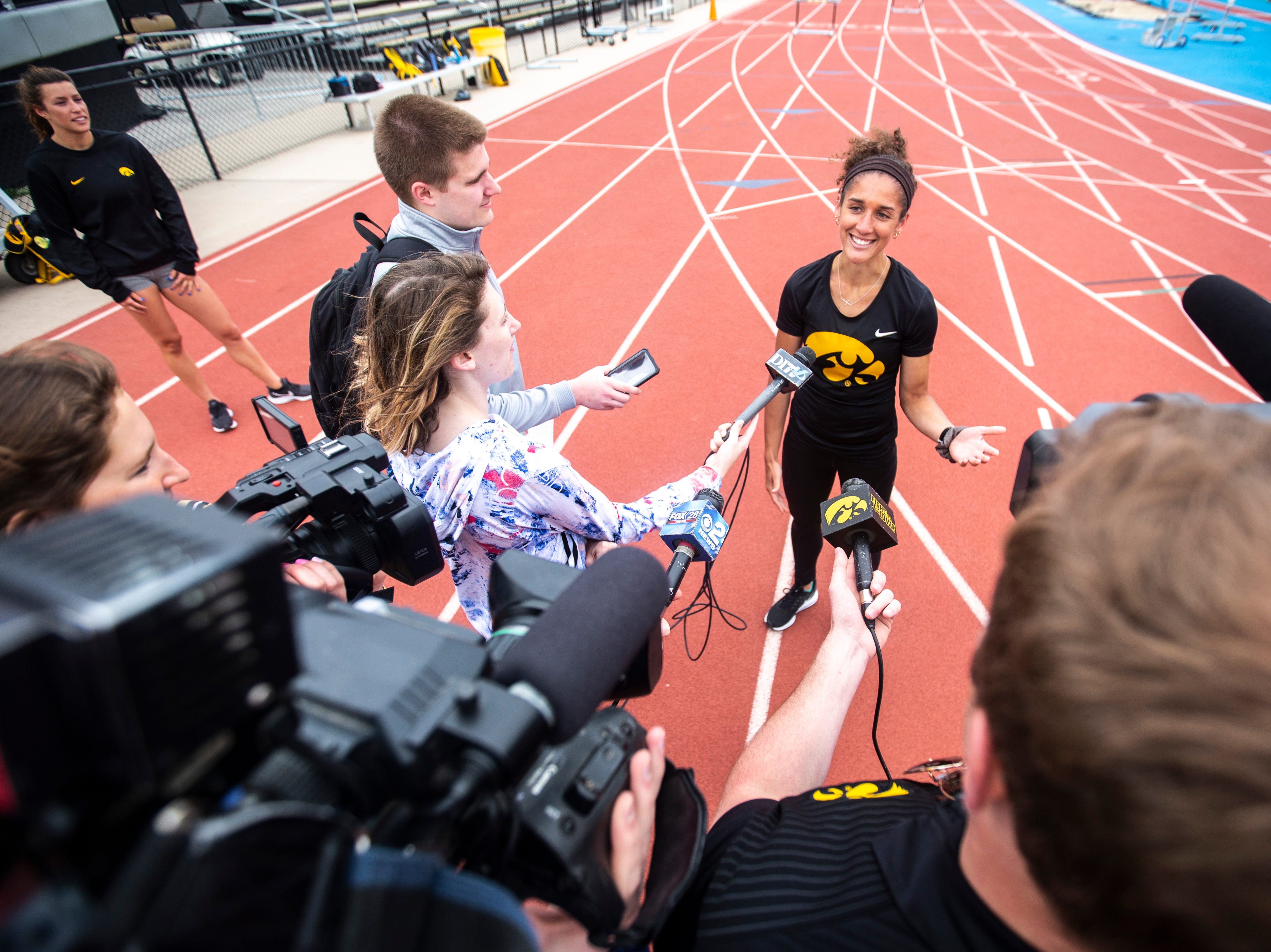 Iowa runner Tia Saunders speaks with reporters, Tuesday, May 7, 2019, Francis X. Cretzmeyer Track in Iowa City, Iowa. Saunders is an Iowa City West High graduate.