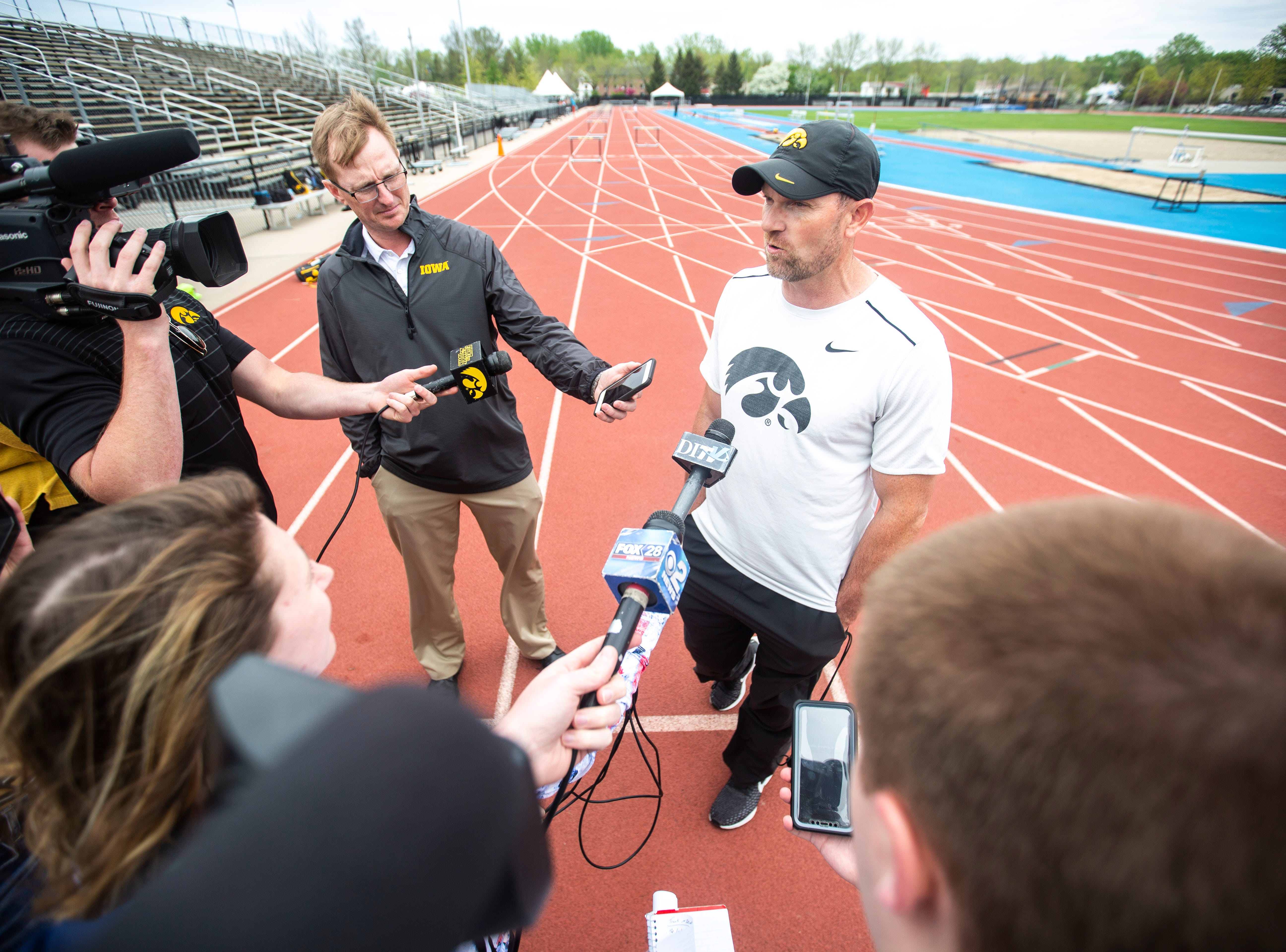 Joey Woody, the University of Iowa director of track and field, speaks with reporters, Tuesday, May 7, 2019, Francis X. Cretzmeyer Track in Iowa City, Iowa.