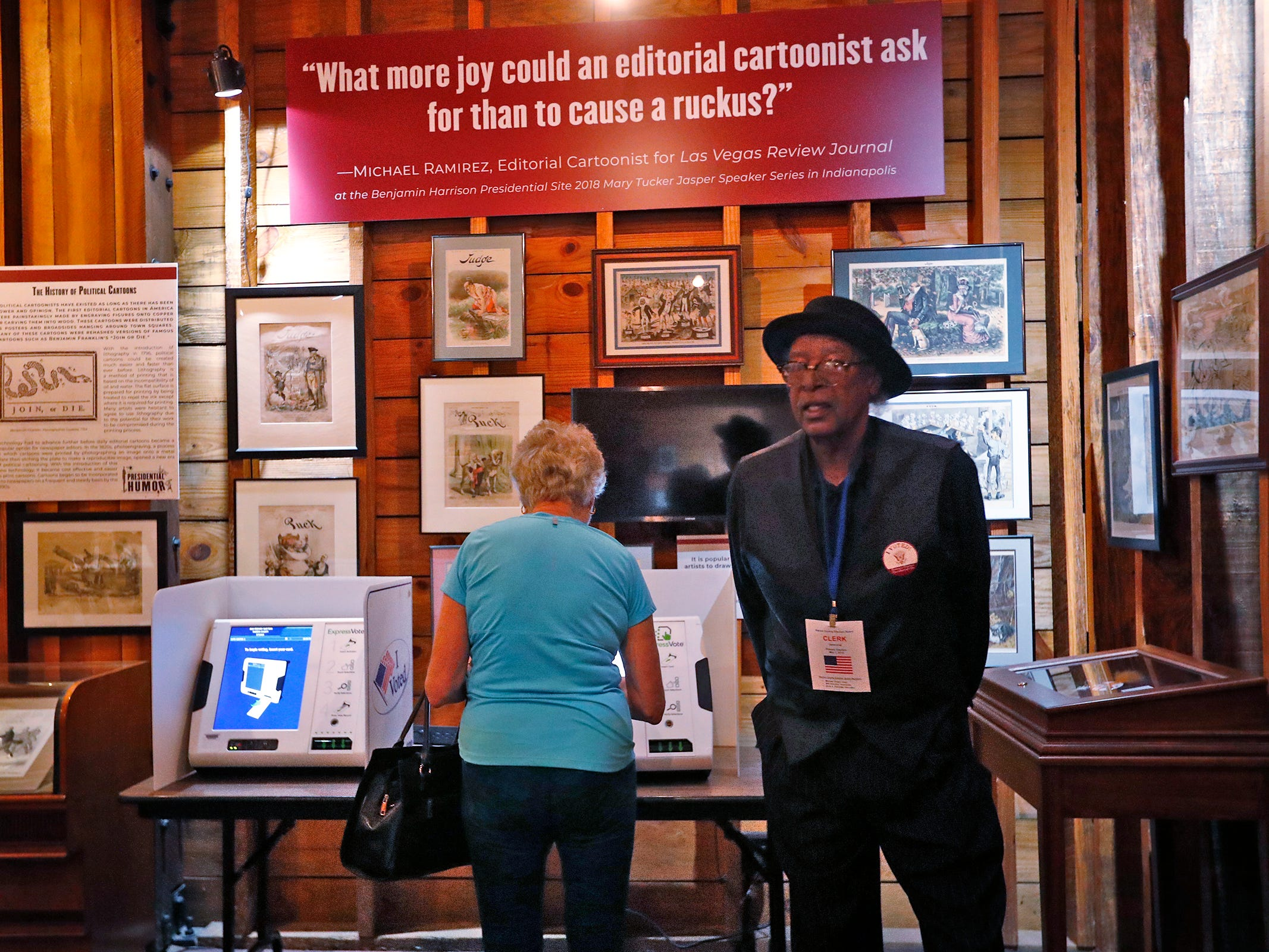 Election Clerk Dwight Watson, right, turns his back to a voter so she can have privacy, as he helps her at the President Benjamin Harrison Presidential Site voting center, Tuesday, May 7, 2019.   As a center, anyone who lives in Marion County can vote here.