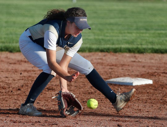 Decatur Central Hawks shortstop Kenzee Smith fields a ground ball in their game against the Warren Central Warriors during the Marion County girls softball tournament at Ben Davis High School on Monday, May 6, 2019.