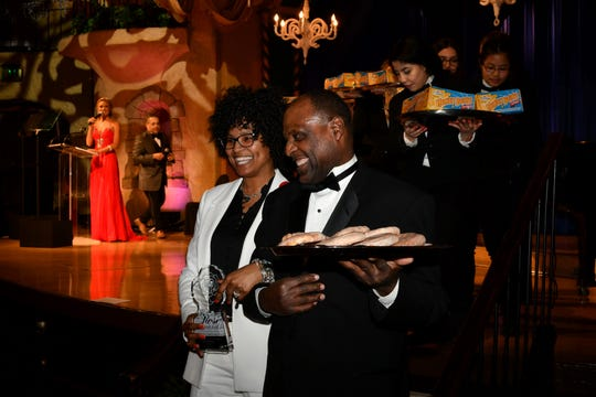 """IndyGo bus operator Misti """"Honey Bun"""" El-Shabazz is presented with a ROSE Award and boxes of honey buns."""