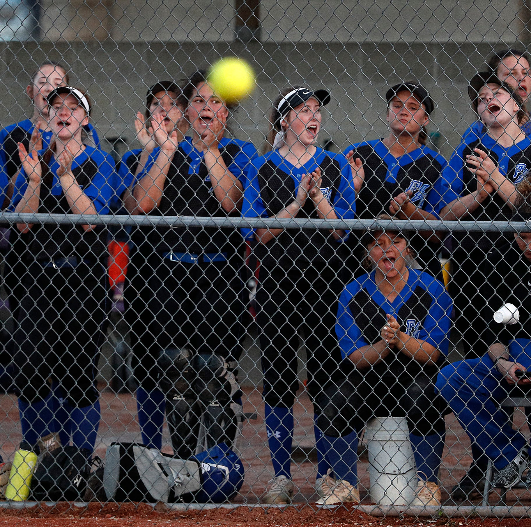 The Franklin Central Flashes cheer on their teammates during the Marion County girls softball tournament at Ben Davis High School on Monday, May 6, 2019.