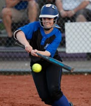 FILE – Franklin Central's Raigan LaMar (15) lays down a bunt against Speedway  during the Marion County girls softball tournament on Monday. Thursday, the Flashes surprised Roncalli.