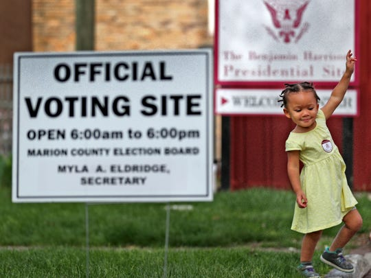 Rali Storey plays after her babysitter voted at the President Benjamin Harrison Presidential Site voting center, Tuesday, May 7, 2019.  As a center, anyone who lives in Marion County can vote at this location.
