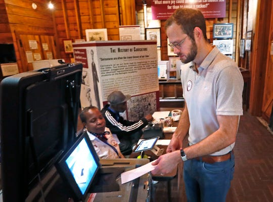 Christian Smeltzer casts his vote at the President Benjamin Harrison Presidential Site voting center, Tuesday, May 7, 2019.  As a center, anyone who lives in Marion County can vote at this location.