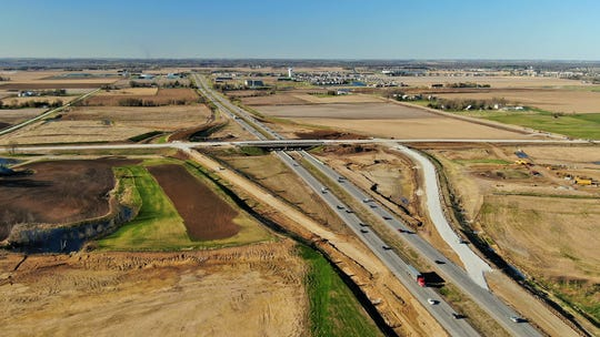 This drone photo taken looking north in late April shows paving progress on the new West Forevergreen Road interchange with I-380 at the North Liberty/Coralville boundary line. The project is expected to be completed this fall.