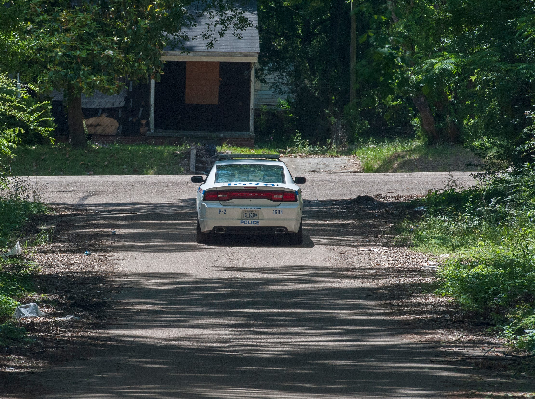 A Jackson Police cruiser drives along Willing Avenue where a woman was shot to death during a domestic dispute on Sunday, May 5, 2019. Maurice Clincy, 35, is charged with murder in the death of his 37-year-old girlfriend, Nicole Newsome, following a domestic dispute as the couple walked on Willing Avenue near the intersection of Ellis Avenue.