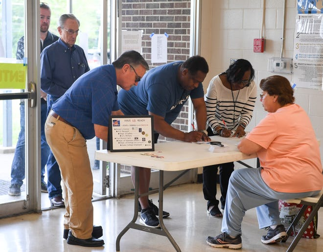 Voters sign in to cast their ballots at North Side High School, Tuesday, May 7, in the 2019 Jackson Mayoral and City Council elections.
