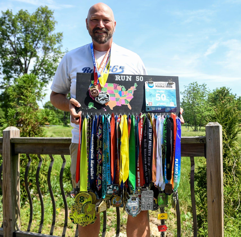 Jackson native Scott Stader finishes 50th marathon in 50th state