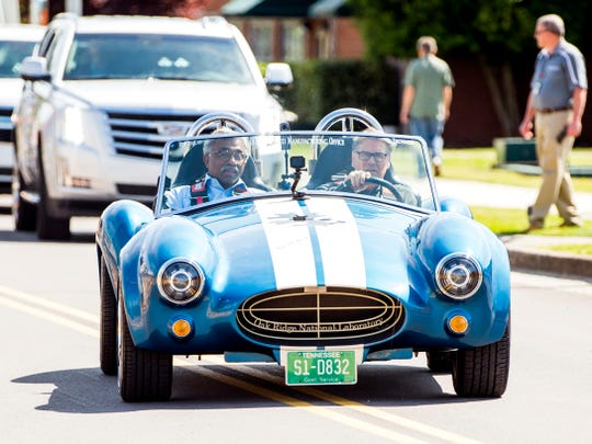 U.S. Energy Secretary Rick Perry, right, and ORNL Director Thomas Zacharia take a drive in a 3D-printed car at Oak Ridge National Laboratory on Tuesday, May 7, 2019.