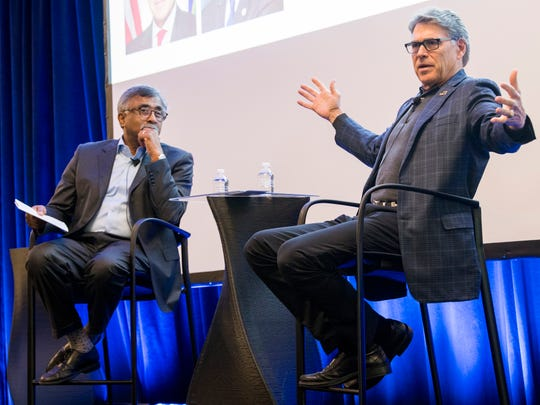 "Oak Ridge National Laboratory Director Thomas Zacharia, left, and U.S. Energy Secretary Rick Perry, speak during a ""fireside chat"" at Oak Ridge National Laboratory on Tuesday, May 7, 2019."