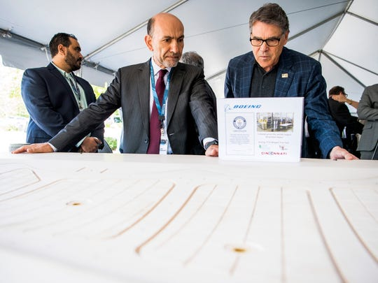 Boeing's Leo Christodoulou, left, shows U.S. Energy Secretary Rick Perry, right, a Boeing 777X winglet trim tool, once the world's largest 3D-printed item, during a technology showcase at Oak Ridge National Laboratory on Tuesday, May 7, 2019.