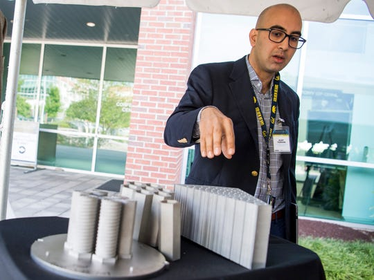 Oak Ridge National Laboratory's Kurt Terrani talks about a 3D-printed conceptual block design for a nuclear reactor core during a technology showcase at ORNL on Tuesday, May 7, 2019.