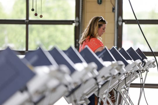 Deanna Lesher of Lafayette casts her vote in the primary election, Tuesday, May 7, 2019 at Lafayette Fire Station No. 5 in Lafayette.