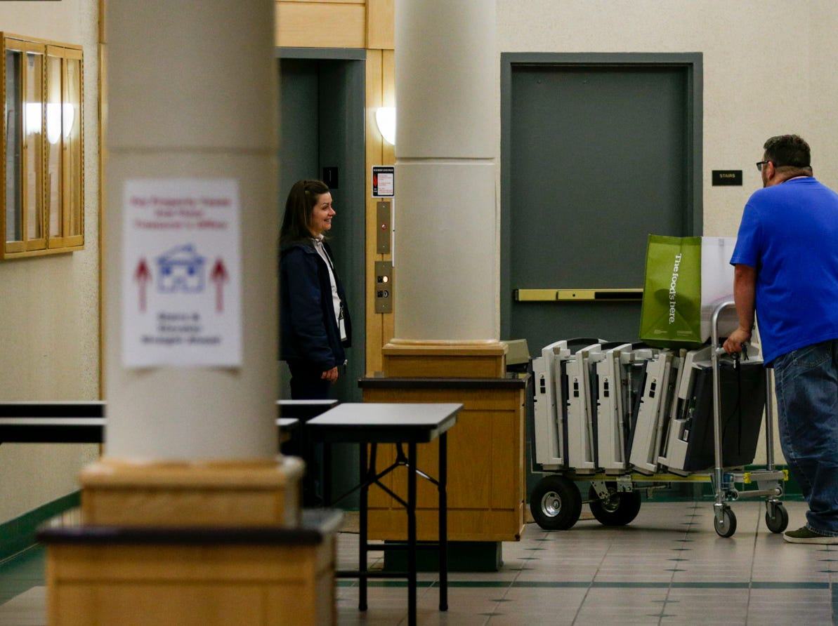 Ballot machines are carted into the Tippecanoe County Building, Tuesday, May 7, 2019 Lafayette.