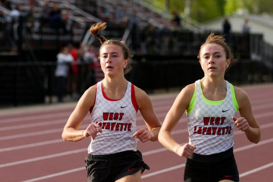 West Lafayette's Ellie Tate, left, and Emma Tate compete in the girls 1600 meter run during the Lafayette City County track meet, Monday, May 6, 2019 at Lafayette Jeff High School in Lafayette.