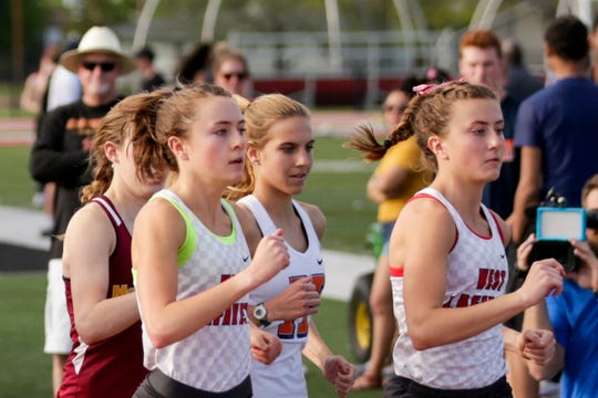 West Lafayette's Emma Tate, left, and Ellie Tate compete in the girls 1600 meter run during the Lafayette City County track meet, Monday, May 6, 2019 at Lafayette Jeff High School in Lafayette.