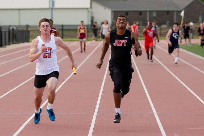 Harrison's Stevie Coffing and Lafayette Jeff's Derrick Matthews competes in the boys 4x100 meter relay during the Lafayette City County track meet, Monday, May 6, 2019 at Lafayette Jeff High School in Lafayette.