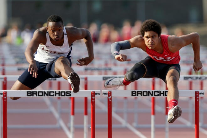 Harrison's Isaac Armstrong and West Lafayette's Kyle Hazell competes in the boys 110 meter hurdles during the Lafayette City County track meet, Monday, May 6, 2019 at Lafayette Jeff High School in Lafayette.