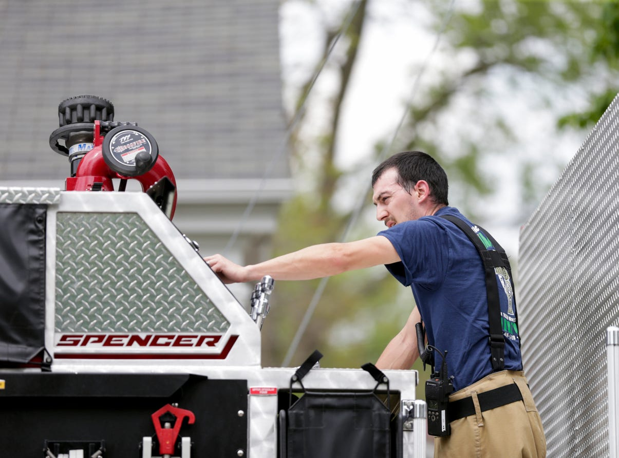 Fire crews work the scene of a structure fire on the 700 block of Walnut st., Tuesday, May 7, 2019 in Dayton. No injuries were reported but one dog and three cats were killed in the fire that started in the kitchen according to fire officials.